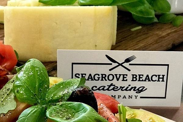 cheese and produce with catering signage